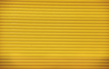 textured wall: Yellow metal textured wall background