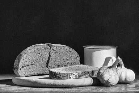 Still life of bread,  garlic, water jug in blak and white