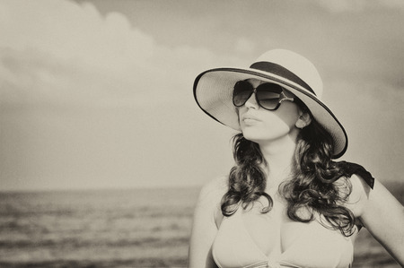 Young beautiful woman on the beach Standard-Bild
