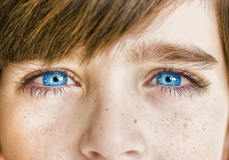 eye lashes: insightful look blue eyes boy Stock Photo