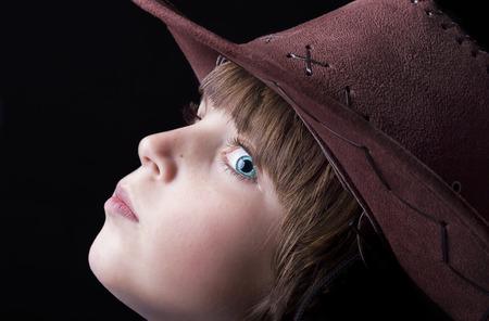 freckle: Cute freckle faced boy wearing a cowboy hat.