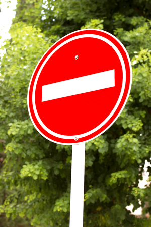 lawful: A red stop sign with trees in the background Stock Photo