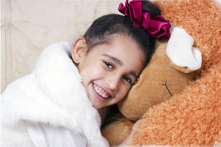 swarthy: Little cute swarthy brunette girl with toy sheep