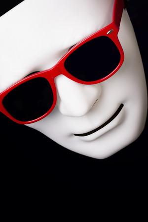 impassive: carnival mask in red sunglasses