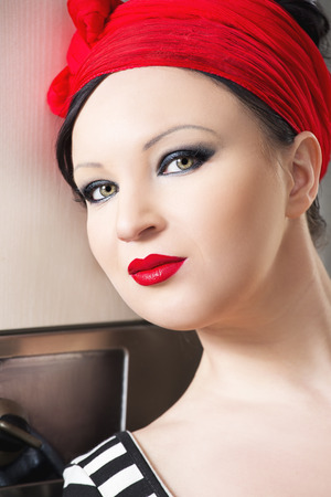 upsweep: Fashion photo of sexy young brunet pin-up girl with beautiful eyes and full red lips wearing in the stripes top