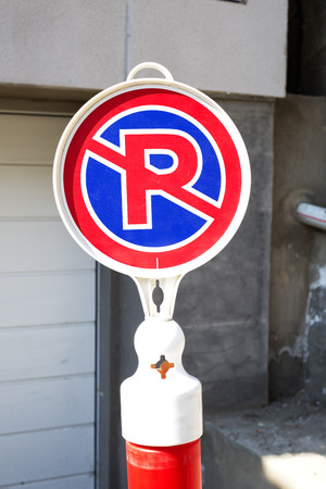 no parking sign: white red and blue no parking sign on the street Stock Photo