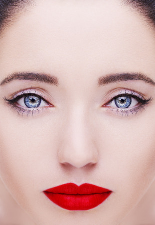 Gorgeous young woman with long eyelashes. Perfect makeup. Stock Photo