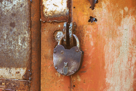 ?ld rusty bolt with lock on the iron gate closed