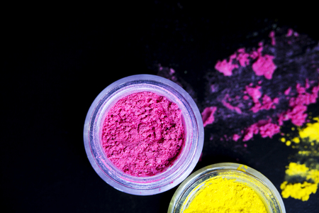 Pink  and yellow eye shadow powder isolated on black background Stock Photo