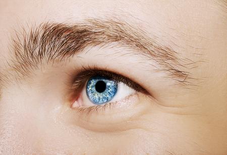 Image of mans blue eye close up.