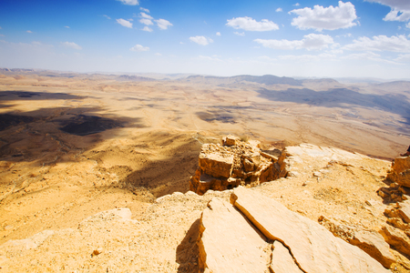 prisma: The bottom of Ramon Crater (Makhtesh Ramon), the largest in the world, as seen from the high rocky cliff edge surrounding it from the north, Ramon Nature reserve, Mitzpe Ramon, Negev desert, Israel