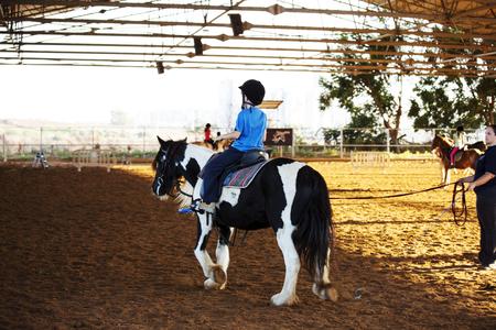 Ber Yakov, Israel - September 28, 2016: Horse riding lessons for kids. Stock Photo