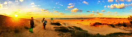 Blurred people having sunset beach in summer vacation. Blurred background.