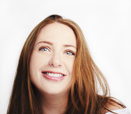 Beautiful young redhead woman with freckles portrait isolated on white. Stock Photo