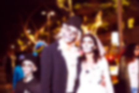 Abstract blurred background. People dressed as a zombie parades on a street during a zombie walk Stock Photo