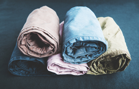 Close Up rolled of pants showing texture isolated on dark background Stock Photo