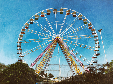 Colorful ferris wheel on blue sky background in Luna Park. Vintage effect Stock Photo