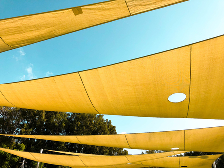 Awning in the midday sun against the sky. Stock Photo