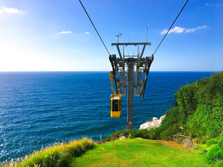Yellow cable car lift at Rosh Hanikra grottoes, Mediterranean sea, Israel.