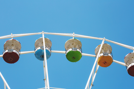 Colorful ferris wheel on blue sky background in Luna Park