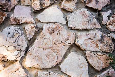 Close up of natural stone wall. Stone wall texture.