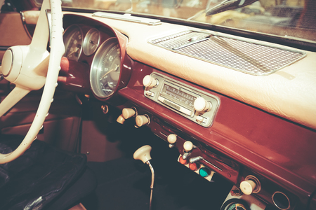 Steering wheel and dashboard in interior of old retro automobile.