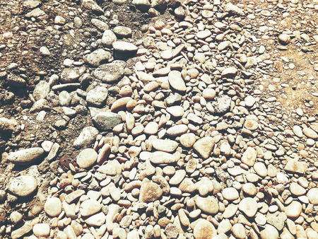 Backgroung of rock gravel pebbles of different size and shape.