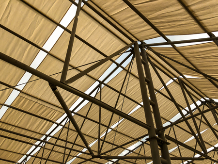Awning in the midday sun against the sky