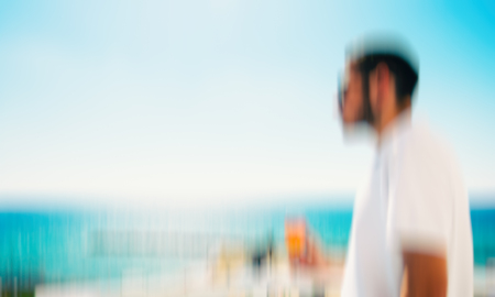 Man enjoying on blue sky sea outdoors background. Abstract motion blur effect Foto de archivo - 102802926
