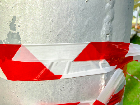 Red white tape to prohibit twisting the stab in the street.