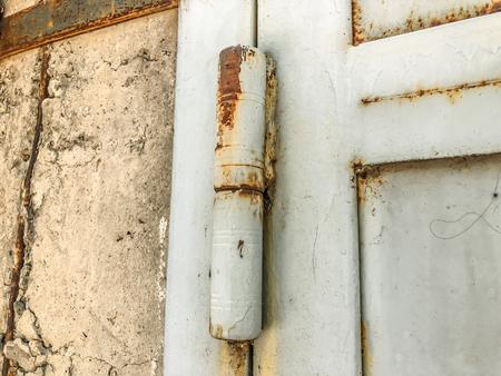 Iron garage doors. Rusty door. Door hinges. Close up shot.