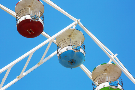 Colorful ferris wheel on blue sky background in Luna Park