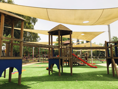 Park with set of modern kids playground background in Gan Be Ivrit, Rishon Le Zion.