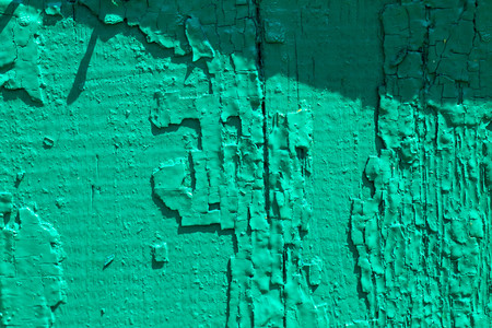 An old crackled painted wood surface. Close-up.
