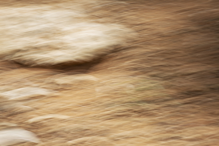 Stone texture on sand. Abstract motion blur effect