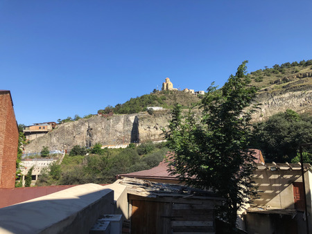 The beautiful view of old Tbilisi. Church on a hill against the blue sky.