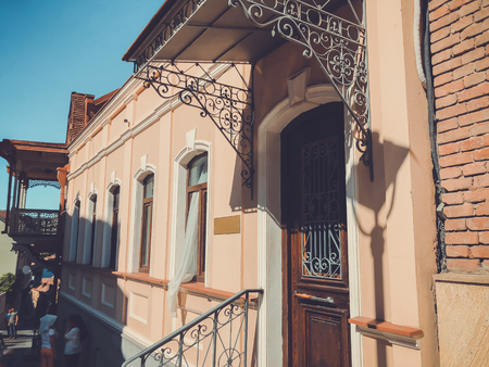Old Tbilisi architecture. The window, the door and exterior decor in summer day.