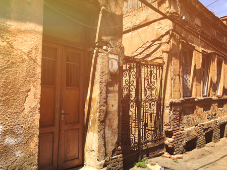 Old Tbilisi architecture, iron gates, windows, doors and exterior decor in summer day