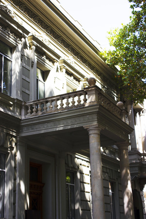 Old Tbilisi architecture, windows and balcony exterior decor in summer day.