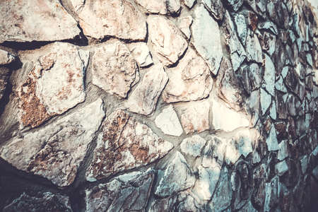 Close up of natural stone wall. Stone wall texture.