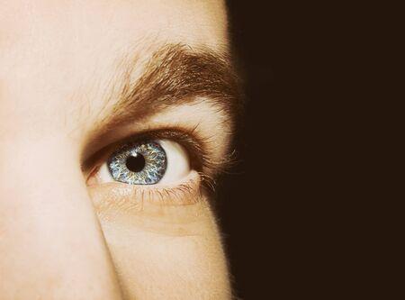 Image of man's blue eye close up.