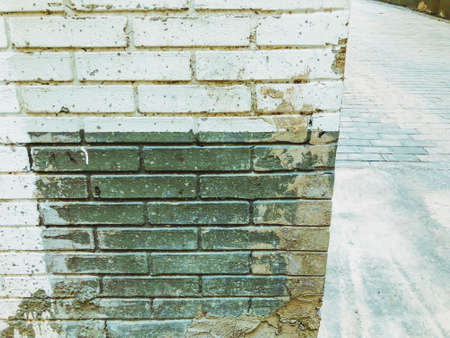 Brick wall. Architecture. Gray and white stone. Brick building. Standard-Bild