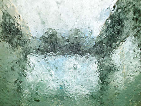 Carwash foam view from inside the car