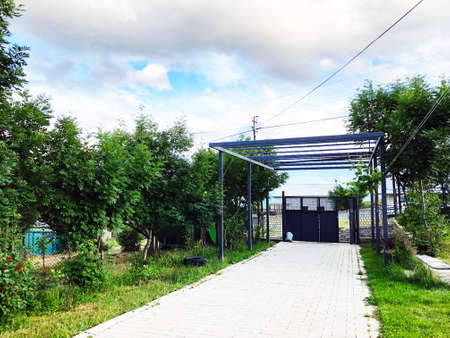 Outdoor in summer residence. Entrance gate in the yard of the house. Imagens - 150631012