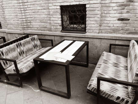 Old Tbilisi architecture, cafe table and chairs in summer day. Imagens - 150631019