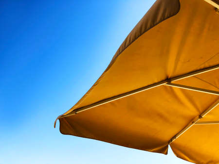 Awning in the midday sun against the sky. Imagens - 150637049
