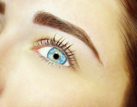Young woman with permanent eyebrows makeup, closeup.