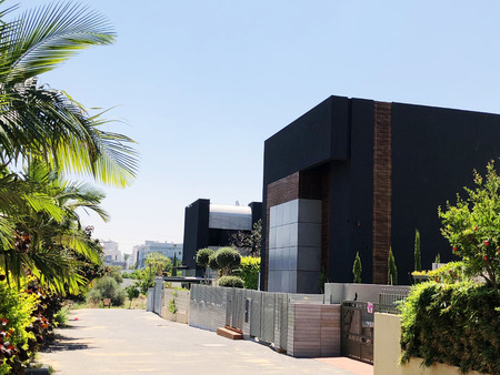 Private modern house on the streets and beautiful trees in Rishon Le Zion, Israel.