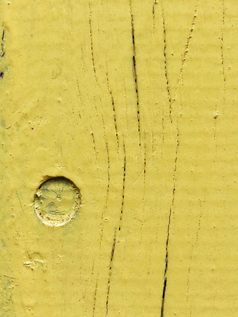 Wooden fence painted in yellow colors . Close up shot. Stok Fotoğraf