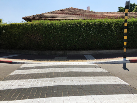 Crosswalk pedestrian crossing on asphalt road in the street.